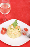 Risotto with shrimps served on a white plate Royalty Free Stock Photos