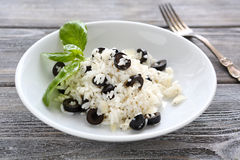 Risotto with slices of black olives Stock Photo