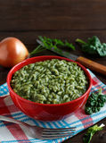 Risotto with spinach cream Stock Images