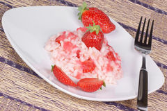Risotto with strawberries. Served on a white plate. Studio shot Stock Images