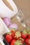 Risotto with strawberries ingredients. Ingredients for risotto with strawberries: rice, strawberries, shallot, white wine and vegetable stock. Selective focus Stock Photo