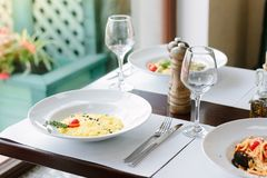 Risotto on a table at traditional italian restaurant. Risotto on a table at traditional italian restaurant stock image