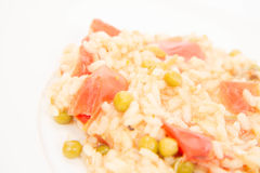 Risotto with tomato and pea Stock Photos