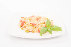 Risotto with tomato and pea Royalty Free Stock Photos