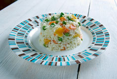 Risotto Tricolore. Italian risotto with yellow  bell pepper, green beans and carrot Stock Photo