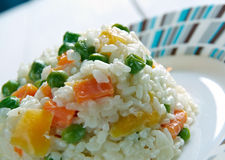 Risotto Tricolore. Italian risotto with yellow  bell pepper, green beans and carrot Stock Photography