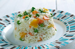 Risotto Tricolore. Italian risotto with yellow  bell pepper, green beans and carrot Stock Image