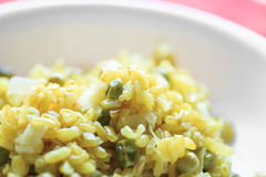 Risotto with turmeric, ginger, peas and leek Closeup Royalty Free Stock Images