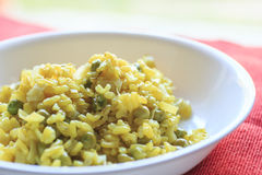 Risotto with turmeric, ginger, peas and leek Royalty Free Stock Photo