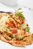 Risotto with vegetable and chicken meat Stock Photo