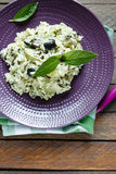 Risotto with vegetables and basil, top view. Food close up Royalty Free Stock Photography
