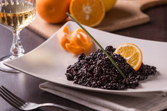Risotto venere. Riso nero rice black with cuttlefish ink Stock Photo