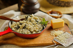 Risotto with  wild mushroom served little red pan Royalty Free Stock Image