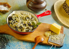 Risotto with  wild mushroom served little red pan Royalty Free Stock Photos