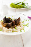Risotto with wild mushrooms and grilled vegetables. Closeup Stock Photo