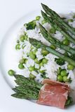 Risotto With Asparagus And Green Peas Macro. Top View Stock Photography