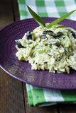 Risotto with zucchini slices and olives. Close up Royalty Free Stock Photography