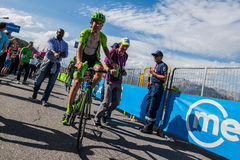 Risoul, France May 27, 2016; Davide Formolo, Cannondale Team, exhausted passes the finish line and meet his fans after a hard moun Royalty Free Stock Photos
