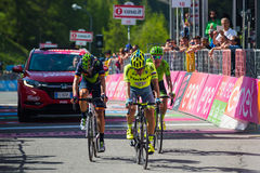 Risoul, France May 27, 2016; A group of professional cyclist exhausted with Rigoberto Uran and Alejandro Valverde passes the finis Stock Photography