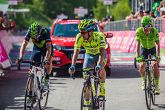 Risoul, France May 27, 2016; A group of professional cyclist exhausted with Rigoberto Uran and Alejandro Valverde passes the finis Royalty Free Stock Photos