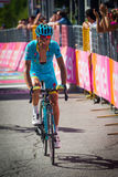 Risoul, France May 27, 2016; Michele Scarponi, Astana Team, exhausted passes the finish line after a hard mountain stage Royalty Free Stock Photo