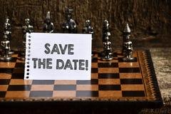 Risparmi di rappresentazione della nota di scrittura la data Foto di affari che montra riserva la data futura citata di nozze sul immagine stock