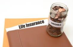 Risparmi i soldi su assicurazione sulla vita Fotografia Stock