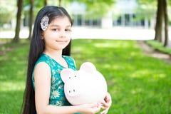 Risparmio dei bambini fotografia stock