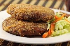 Rissóis cozinhados para o Hamburger Fotografia de Stock Royalty Free