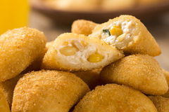 Rissole - Corn and cheese rissole served with chili sauce on woo Royalty Free Stock Photo