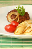 Rissole with grilled bacon and onion Royalty Free Stock Image