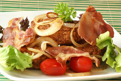 Rissole with grilled bacon and onion Royalty Free Stock Photo