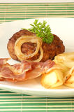 Rissole with grilled bacon and onion Royalty Free Stock Photos