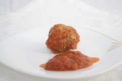 Rissole of mincemeat with tomato sauce Stock Photos