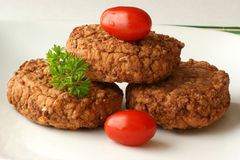 Rissole with plum tomato and parsley Royalty Free Stock Image