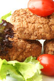 Rissole with plum tomato and salad Royalty Free Stock Photography