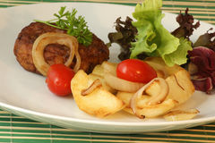 Rissole with potato and organic tomato Royalty Free Stock Images