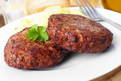 Rissole with potato salad stock images