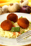 Rissole with  rice on a plate Royalty Free Stock Images