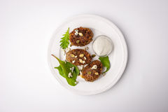 Rissoles мяса с семенами тыквы и dorblu соуса Стоковое фото RF
