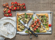 Ristic mushroom (fungi) square pizza with cherry tomatoes and ar Stock Photo