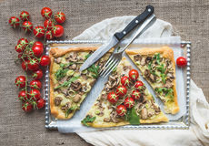 Ristic mushroom (fungi) square pizza with cherry tomatoes and ar Royalty Free Stock Photo
