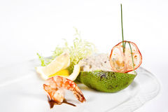 Ristotto with seafood in avocado stock photo