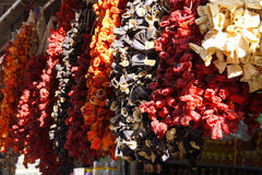 Ristras of dried eggplant and peppers  hanging in the bazaar  in Royalty Free Stock Photo