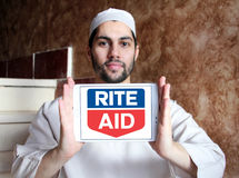 Rite Aid pharmacy logo. Logo of Rite Aid pharmacy on samsung tablet holded by arab muslim man. Rite Aid Corporation is an American drugstore chain in the United Stock Photo