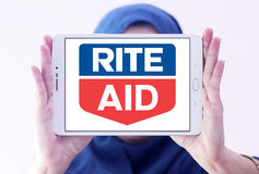 Rite Aid pharmacy logo. Logo of Rite Aid pharmacy on samsung tablet holded by arab muslim woman. Rite Aid Corporation is an American drugstore chain in the Stock Images