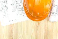 Ritningar för golvplan med säkerhetshjälmen Arkivfoto