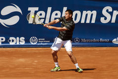 Ritorno del giocatore di tennis una sfera Immagine Stock Libera da Diritti