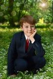 Ritratto all'aperto del ragazzo che va alla prima comunione santa Fotografie Stock