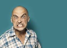 Ritratto arrabbiato dell'uomo fotografia stock